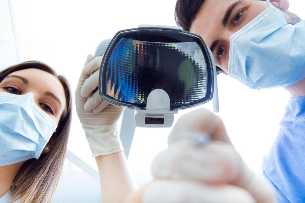 two doctors hovering over camera | oral sedation dentistry irvine ca