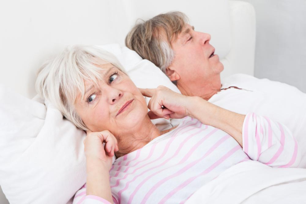 woman plugging her ears from her husband snoring | sleep apnea treatment irvine ca