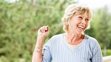 woman smiling | dental implants irvine ca