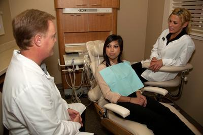 Dr. Robertson with patient | dentist irvine ca